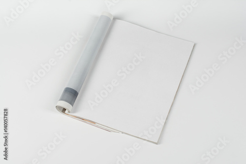Obraz Mock-up magazine or catalog on white table. Blank page or notepad on neutral background. Blank page or notepad for mockups or simulations. - fototapety do salonu