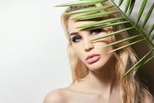 Beautiful Sexy Woman Behind A Palm
