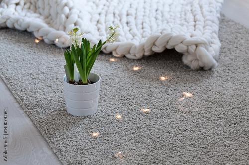 Foto op Plexiglas Stenen in het Zand White scandinavian interior with knit plaid.