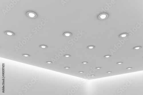 Fotografía  Office ceiling of empty white room with round ceiling lamps
