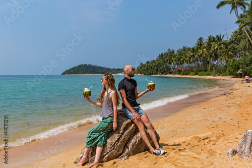 Canvas Prints Textures Couple drinking coconut juice on the beach