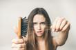 Leinwandbild Motiv Woman with hair comb loss hairs close up