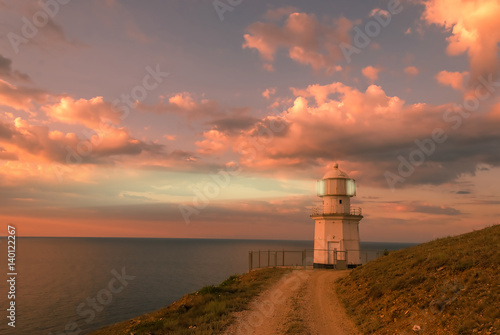 Poster Corail Evening Landscape with Lighthouse