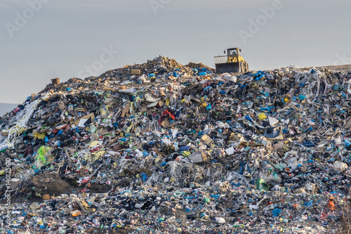 Pollution concept. Garbage pile in trash dump or landfill. Wallpaper Mural