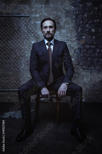 Fotografie, Obraz  Handsome bearded man looking dangerous