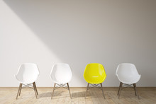 Three White Chairs And A Yellow One