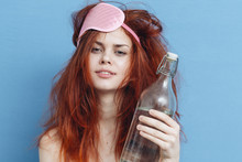 Brunette With A Bottle Of A Hangover