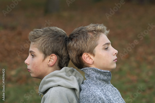 Fotografie, Obraz  Boy twins standing quietly back to back