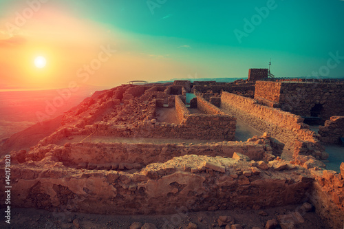 Recess Fitting Deep brown Beautiful sunrise over Masada fortress. Ruins of King Herod's palace in Judaean Desert.