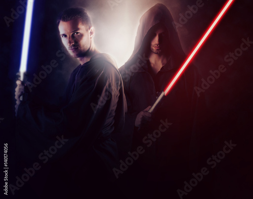 Photo  Two handsome warrior holding a light saber