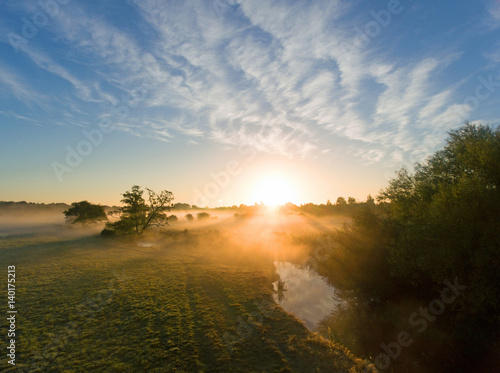misty riverbank sunrise essex фототапет