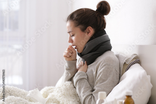 Young ill woman in bed at home Canvas Print