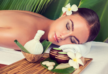 Obraz na płótnie Canvas Body care. Spa body massage treatment with hot herbal ball for deep relaxation . Woman having massage in the spa salon