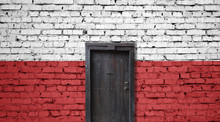 Poland Flag On Brick Wall. Closed Door In A Wall