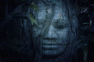 Ancient face at a mysterious ruins in jungle