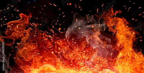 Fotobehang Vuur Firestorm texture. Bokeh lights on black background, shot of flying fire sparks in the air