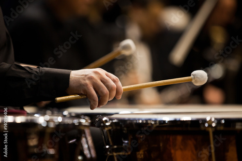 Canvastavla Hands musician playing the timpani in the orchestra closeup in dark colors