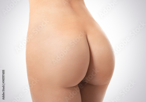 Obraz na plátně  Buttocks of beautiful young woman on white background