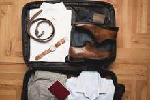 Open Traveler's Bag With Men C...