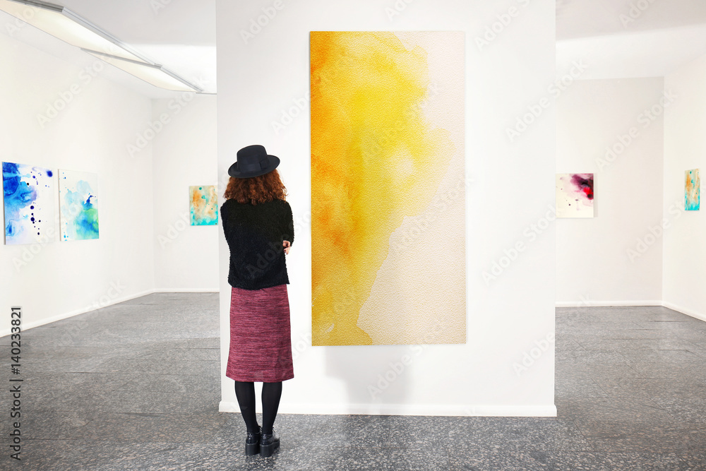 Fototapety, obrazy: Young woman in modern art gallery