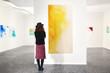 Leinwandbild Motiv Young woman in modern art gallery