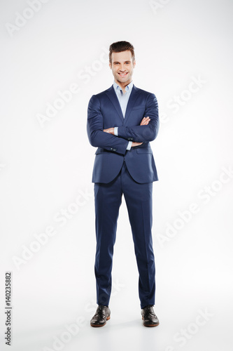 Fotografie, Obraz  Full length image of smiling man with crossed arms