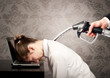 businessman with fuel pump on his back sleeping on laptop