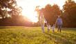 Leinwandbild Motiv Family running in park