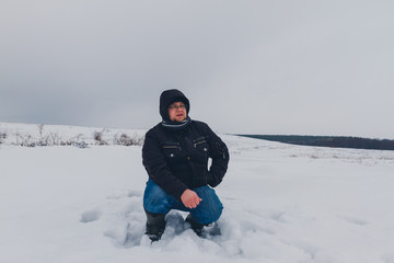 Fototapeta na wymiar traveler walking in a winter steppe