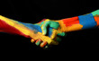 canvas print picture - Hand Shaking Gesture of Oil Painted Hands Diversity concept