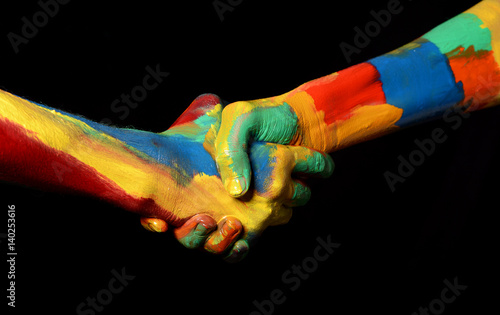 hand shaking gesture of oil painted hands diversity concept buy