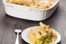Chicken Divan Casserole With Broccoli And Rice On Small White Plate With Dark Wooden Background Horizontal Shot