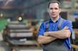 Service man worker at factory workshop background
