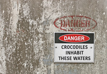 Red, Black And White Danger, Crocodiles Inhabit These Waters Warning Sign