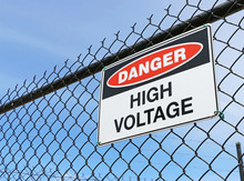 Danger, High Voltage Sign On F...