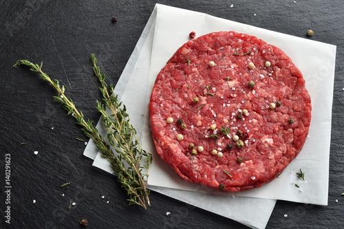 Fotografiet Fresh raw Prime Black Angus beef burger patty