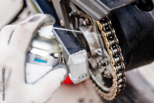 Photo  Lubricating motorcycle chain