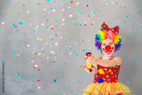 Spoed Foto op Canvas Carnaval Funny kid clown playing indoor