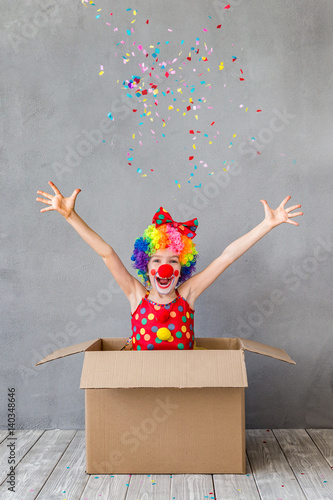 Photographie Funny kid clown playing indoor