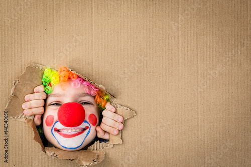 Deurstickers Carnaval Funny kid clown playing indoor