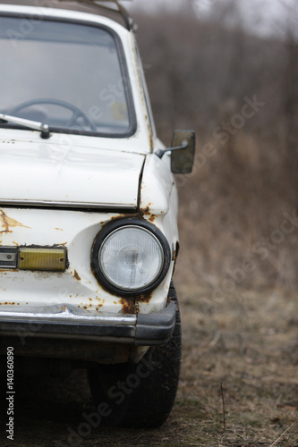 Old car white on a nature background © andrii kornev