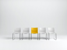 Row Of Empty Chairs On White
