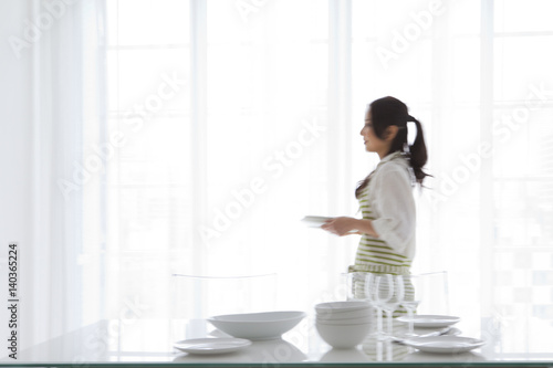 A woman setting a table