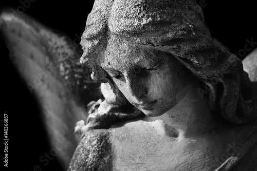Beautiful close up af a face angel marble sculpture with a sweet expression that Canvas Print