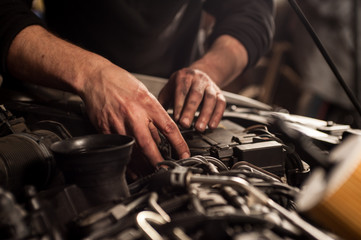 mechanic fixing a car at home