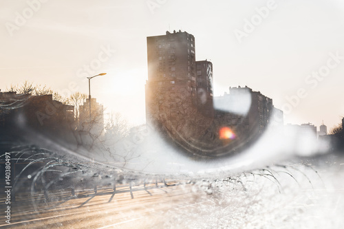 Photo  Double exposure of an eye with city street