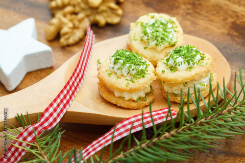 Christmas sweets on a wooden spoon