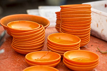 Orange Bowls Stacked On The Street Food Stall