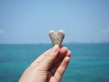 Hand Holding Heart Shape Stone...