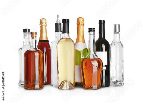 Poster de jardin Bar Different bottles of wine and spirits on white background